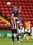 Samir Carruthers of Sheffield Utd with John Rooney of Millwall during the U23 Professional Development League Two match at Bramall Lane Stadium, Sheffield. Picture date 18th August 2017. Picture credit should read: Simon Bellis/Sportimage