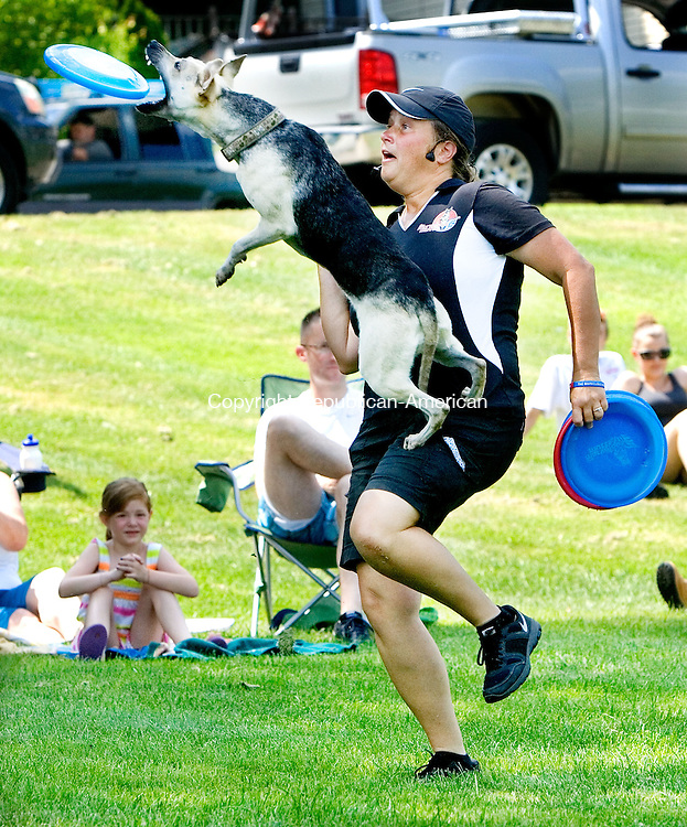 WATERBURY CT. 16 July 2013-071713SV06-Kara Gilmore and her dog &ldquo;Shazam&rdquo; perform at Sanford Field in Thomaston Wednesday. The Thomaston Public Library hosted the Marvelous Mutts show that was funded by the Friends of the Thomaston Public Library.<br /> Steven Valenti Republican-American