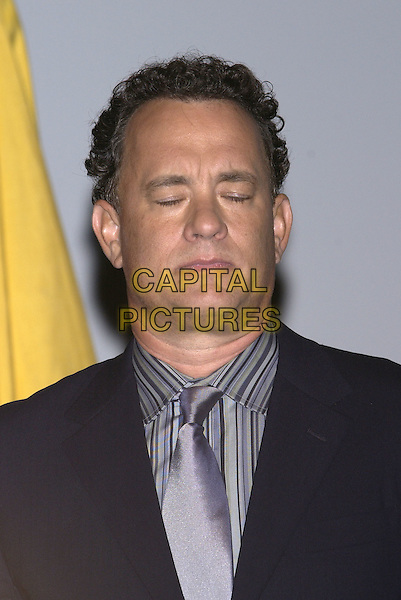 "TOM HANKS .Screening of ""The Terminal"".Deauville Film Festival, France, 4th September 2004..portrait headshot eyes closed funny face.Ref: PL.www.capitalpictures.com.sales@capitalpictures.com.©Capital Pictures."