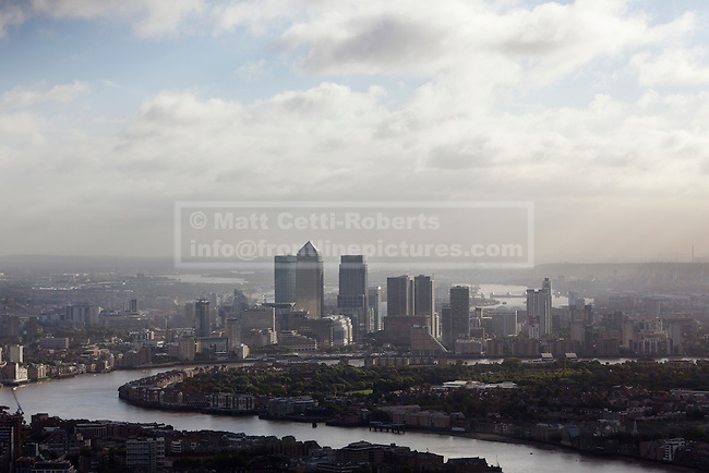 10/10/2013. London, UK. The River Thames, Canary Wharf and the Isle of Dogs are seen on a sunny autumn morning from the viewing platform close to the summit of the Shard in London.  Photo credit: Matt Cetti-Roberts