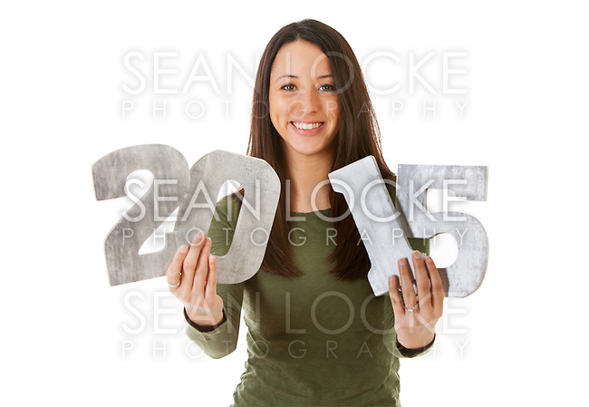 Series with a young man and woman celebrating New Year's Eve, some with 2015 as the subject, isolated on white.