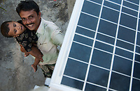 BANGLADESH , Sundarbans, village Burigoalinoi , micro-finance bank Grameen Shakti and NGO Srizony , promote micro-credit financed Solar Home Systems in villages, happy villager
