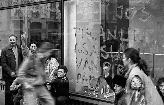 "ROMANIA, Magheru Bd., Bucharest, 22.12.1989, 4 pm..Magheru boulevard in the centre: More than one million people are celebrating Ceausescu's running away. On the window it is written ""Down with the tyran, killer, vampire, paranoid"".© Andrei Pandele / EST&OST"