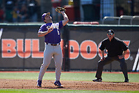 LSU Tigers first baseman Drew Bianco (5) catches a pop fly as first base umpire Darrell Arnold looks on during the game against the Georgia Bulldogs at Foley Field on March 23, 2019 in Athens, Georgia. The Bulldogs defeated the Tigers 2-0. (Brian Westerholt/Four Seam Images)