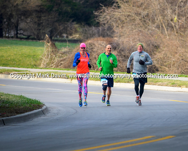 Donna Gaunt, Kraig Daugherty and Jeff Allsup round the curve near the overpass in Pleasant Hill as they make their way through the Springtime Hill Climb 10K run. Caring Hands of Altoona in conjuction with Pleasant Hill hosted the fifth annual event April 1.