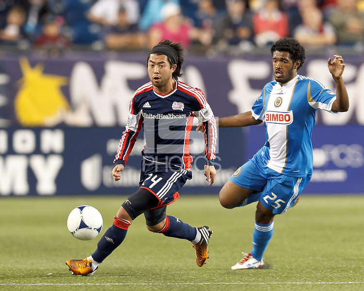 New England Revolution midfielder Lee Nguyen (24) dribbles as Philadelphia Union defender Sheanon Williams (25) closes. In a Major League Soccer (MLS) match, the New England Revolution tied Philadelphia Union, 0-0, at Gillette Stadium on September 1, 2012.