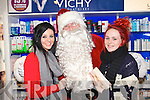 Pictured with Santa at CH Chemist Christmas discount evening on Friday night were l-r: Chloe Carroll (Abbeydorney) Danielle Robinson (Lixnaw)..