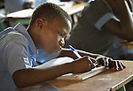 A boy student at the John Paul II School in Wau, South Sudan.
