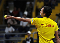 BOGOTA-COLOMBIA, 07-03-2020: Daniel Galan de Colombia, sirve a Juan Ignacio Londero de Argentina, durante partidos de los enfrentamientos para Las clasificatorias Copa Davis by Rakuten 2020 entre Colombia y Argentina en el Palacio de los Deportes en la ciudad de Bogota. / Daniel Galan of Colombia serves to Juan Ignacio Londero of Argentina, during matches of the clashes for the Davis Cup by Rakuten 2020 qualifiers between Colombia and Argentina at the Palacio de los Deportes in Bogota city. / Photo: VizzorImage / Luis Ramirez / Staff.