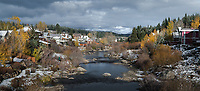 Many aspens still grace the Truckee River after the first winter storm of the season.  This photos was taken in the late afternoon, with the sun breaking through the cloud cover and setting directly behind me - hence the big contrast between the dark water and sky and the lighter colored trees and houses.
