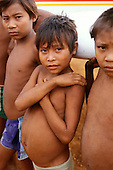 Roraima State, Brazil; malnourished Yanomami children on an illegal gold mine landing strip.
