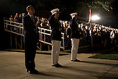 Washington, DC - July 24, 2009 -- United States President Barack Obama, left, Marine Commandant James T. Conway, center, and Washington Marine Corps Barracks Commander Colonel Andrew H. Smith, right, salute the colors during the Evening Parade at the Washington Marine Barracks on Friday, July 24, 2009.   .Credit: Kristoffer Tripplaar / Pool via CNP