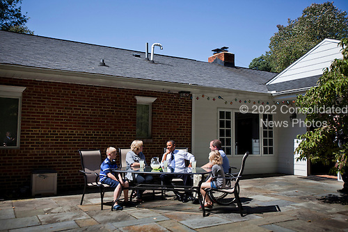 United States President Barack Obama meets with John and Nicole Armstrong, along with their twin children, in the family's backyard to discuss Recovery Act investments in Fairfax, Virginia on 13 September, 2010. .Credit: Jim Lo Scalzo - Pool via CNP