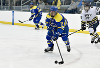 Delaware's Colin Emerich (12) stickhandles to the net. Emerich had 1 goal and 3 assists as Delaware defeated Navy 8-3 at McMullen Hockey Arena.<br /> <br /> Photo by Randy Litzinger