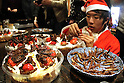 December 24, 2016, Tokyo, Japan - A man puts chocolate covered mealworms on a Christmas cake for the decoration at a Christmas party to eat insect foods in Tokyo on Saturday, December 24, 2016. Some 30 people gathered to eat insect foods on the Christmas Eve as UN FAO reported that eating insects could help boost nutrition and reduce pollution.  (Photo by Yoshio Tsunoda/AFLO) LWX -ytd-