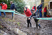 kids playing next to the course and shouting their names (in support) to every rider passing by<br /> <br /> Superprestige Gavere 2014