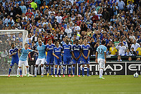 Chelsea players form a wall against a Carlos Tevez free kick..Manchester City defeated Chelsea 4-3 in an international friendly at Busch Stadium, St Louis, Missouri.