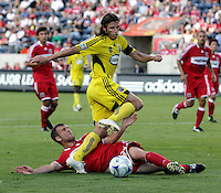 Chicago Fire defender Daniel Woolard (24) slide tackles the ball away from Columbus Crew defender Frankie Hejduk (2).  The Chicago Fire tied the Columbus Crew 0-0 at Toyota Park in Bridgeview, IL on July 11, 2009.