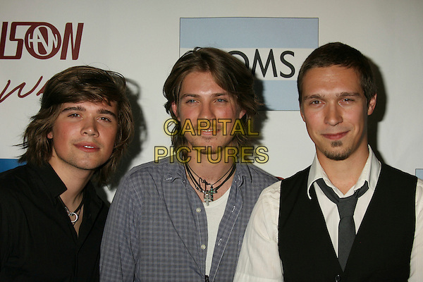 ZAC HANSON, TAYLOR HANSON & ISAAC HANSON.Hanson Teams Up With Toms Shoes For A One Mile Walk from West Hollywood City Hall to the old Tower Records where Hanson performed a mini-concert to help end Poverty and AIDS in Africa, West Hollywood, California, USA..October 30th, 2007.headshot portrait brothers siblings family goatee facial hair .CAP/ADM/RE.©Russ Elliot/AdMedia/Capital Pictures.