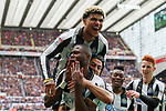Chancel Mbemba of Newcastle United celebrates with team mates after scoring his teams second goal of the game during the EFL Championship match at St James' Park Stadium, Newcastle upon Tyne. Picture date: May 7th, 2017. Pic credit should read: Jamie Tyerman/Sportimage