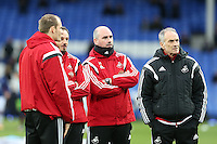 Swansea City Head Coach Francesco Guidolin, right,  pictured with Swansea City Coach Gabriele Ambrosetti, left, and Performance psychologist Ian Mitchell, centre, during the pre match warm up ahead of the  during the Barclays Premier League match between Everton and Swansea City played at Goodison Park, Liverpool