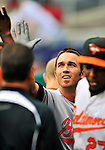 19 June 2011: Baltimore Orioles' infielder J.J. Hardy returns to the dugout after hitting a home run against the Washington Nationals on Father's Day at Nationals Park in Washington, District of Columbia. The Orioles defeated the Nationals 7-4 in inter-league play, ending Washington's 8-game winning streak. Mandatory Credit: Ed Wolfstein Photo