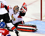 17 October 2009: Ottawa Senators goaltender Pascal Leclaire makes a glove save against the Montreal Canadiens at the Bell Centre in Montreal, Quebec, Canada. The Senators defeated the Canadiens 3-1. Mandatory Credit: Ed Wolfstein Photo