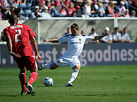 LA midfielder Dema Kovalenko (21) sends in a cross in front of Chicago defender C.J. Brown (2).  The LA Galaxy tied the Chicago Fire 1-1 at Toyota Park in Bridgeview, IL on September 4, 2010