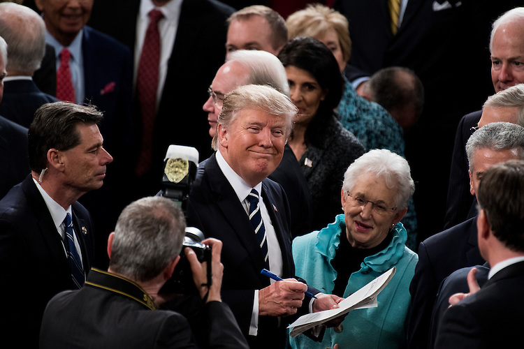UNITED STATES - FEBRUARY 28: President Donald Trump gives an autograph to Rep. Virginia Foxx, R-N.C., after delivering his address to a joint session of Congress on Tuesday, Feb. 28, 2017. (Photo By Bill Clark/CQ Roll Call)