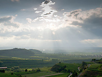 Germany, DEU, Baden-Wurttemberg, Vogtsburg-Bickensohl, 2010Jul28: Sun and clouds above the Kaiserstuhl vineyards.