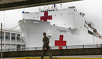 New York, New York City, 3/30/20. The USNS Comfort, a Mercy-class hospital ship, docks at Pier 90. The 1000 beds and 12 operating rooms will be used for non-coronavirus patients to alleviate overworked hospitals due to COVID-19.
