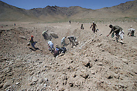 Scrap hunters rush to secure bits of metal at munitions destruction site...Destruction of various munitions by a Weapons and Ammunition Disposal unit from HALO Trust. Collected munitions are blown up in in a remote site. This method is used for mines, landmines, UXO's, aircraft bombs, cluster bomblets, and smaller ammunitions. © Fredrik Naumann