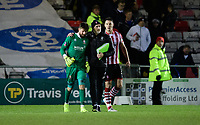 Lincoln City's Josh Vickers, left, with Lincoln City's first team goalkeeping coach Andy Warrington at the end of the game<br /> <br /> Photographer Chris Vaughan/CameraSport<br /> <br /> The Emirates FA Cup Second Round - Lincoln City v Carlisle United - Saturday 1st December 2018 - Sincil Bank - Lincoln<br />  <br /> World Copyright © 2018 CameraSport. All rights reserved. 43 Linden Ave. Countesthorpe. Leicester. England. LE8 5PG - Tel: +44 (0) 116 277 4147 - admin@camerasport.com - www.camerasport.com
