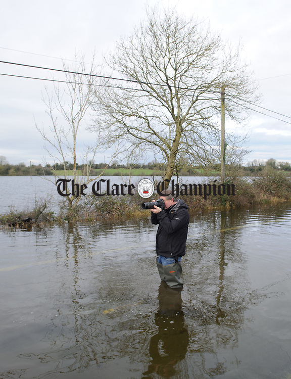 Photographer John Kelly  covering the flooding at Caherbroder, Gort adjacent to the M18 motorway.  Photograph by John Kelly.