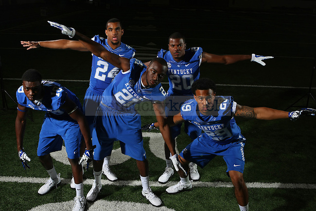 UK's cornerback and defensive back core pose for a photo during UK football media day at Nutter Field House in Lexington, Ky.,on Friday, August 8, 2014. Photo by Michael Reaves | Staff