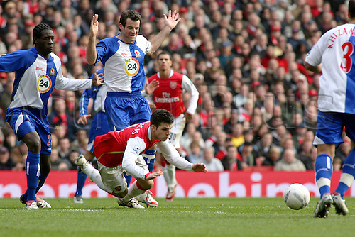 17 February 2007: Blackburn defender Ryan Nelsen trips Cesc Fabregas during the FA Cup 5th Round game between Arsenal and Blackburn Rovers, played at The Emirates Stadium. The game finished 0-0. Photo: Actionplus....070217 football soccer player foul fransesc