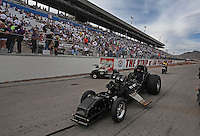 Apr. 5, 2013; Las Vegas, NV, USA: The chassis of NHRA funny car driver Johnny Gray after exploding the body off during qualifying for the Summitracing.com Nationals at the Strip at Las Vegas Motor Speedway. Mandatory Credit: Mark J. Rebilas-