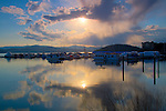 Idaho, North, Kootenai County, Coeur d'Alene. Sun and rain over the Silver Beach Marina.