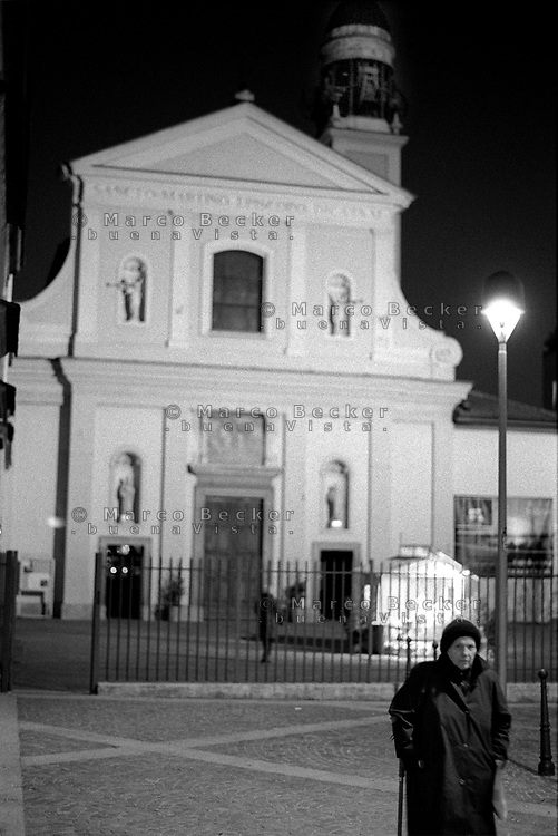 milano, quartiere greco, periferia nord. chiesa e anziana signora--- milan, greco district, north periphery. church and old woman