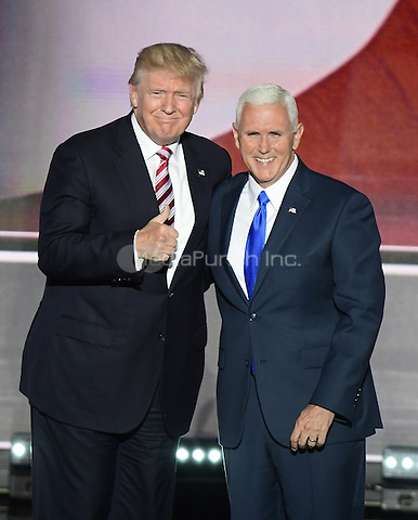 Donald Trump, the GOP nominee for President of the United States greets Governor Mike Pence (Republican of Indiana), the GOP nominee for Vice President of the United States following the Governor's acceptance speech at the 2016 Republican National Convention held at the Quicken Loans Arena in Cleveland, Ohio on Wednesday, July 20, 2016.<br /> Credit: Ron Sachs / CNP/MediaPunch<br /> (RESTRICTION: NO New York or New Jersey Newspapers or newspapers within a 75 mile radius of New York City)