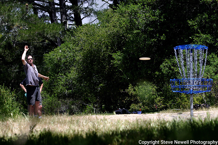 Pro disc golfer Tom Embree putting at the Master's Cup disc golf tournament held at Delaveaga Disc Golf course in Santa Cruz, CA.  I had several photos run in the Disc Golf World News magazine.