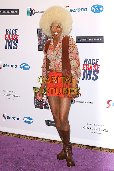 NATALIE COLE<br /> 13th Annual Race to Erase MS - Arrivals held at the Hyatt Regency Century Plaza Hotel, Century City, California, USA, 12 May 2006.<br /> full length blonde afro wig seventies costume platforms brown boots<br /> Ref: ADM/ZL<br /> www.capitalpictures.com<br /> sales@capitalpictures.com<br /> &copy;Zach Lipp/AdMedia/Capital Pictures