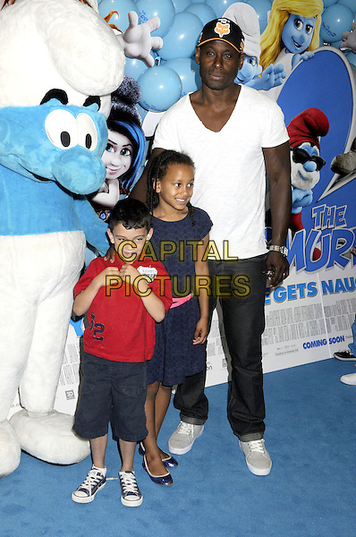 David Harewood &amp; guests<br /> The &quot;The Smurfs 2&quot; gala film screening, Vue West End cinema, Leicester Square, London, England.<br /> July 28th, 2013<br /> full length white t-shirt jeans denim red t-shirt blue dress baseball cap hat<br /> CAP/PP/BK<br /> &copy;Bob Kent/PP/Capital Pictures