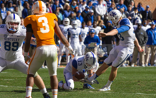 Kentucky Senior place kicker Craig McIntosh puts the ball through the uprights on a point after attempt in Knoxville, Tn., on Saturday, November, 24, 2012. Photo by James Holt | Staff