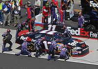 Apr 29, 2007; Talladega, AL, USA; Nascar Nextel Cup Series driver Denny Hamlin (11) pits during the Aarons 499 at Talladega Superspeedway. Mandatory Credit: Mark J. Rebilas
