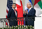 """Sheikh Abdullah bin Zayed bin Sultan Al Nahyan, Minister of Foreign Affairs and International Cooperation of the United Arab Emirates, left, and Prime Minister Benjamin Netanyhu of Israel, right, look on as United States President Donald J. Trump and First lady Melania Trump host a signing ceremony of the """"Abraham Accords"""" on the South Lawn of the White House in Washington, DC on Tuesday, September 15, 2020. <br /> Credit: Chris Kleponis / Pool via CNP"""