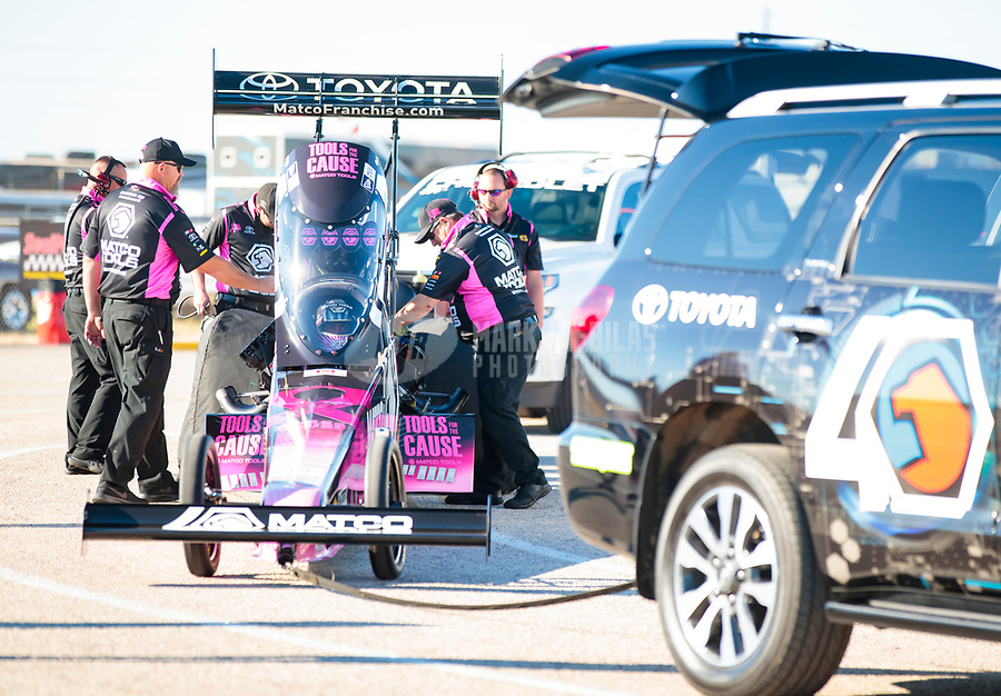 Oct 18, 2019; Ennis, TX, USA; Crew members with NHRA top fuel driver Antron Brown during qualifying for the Fall Nationals at the Texas Motorplex. Mandatory Credit: Mark J. Rebilas-USA TODAY Sports