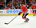 JASSEN CULLIMORE,  of the Chicago Blackhawks in action  during the Blackhawks game against the Calgary Flames at the United Center in Chicago, IL.  The Chicago Blackhawks beat the Calgary Flames 4-2 in Chicago, Illinois on December 5, 2011....