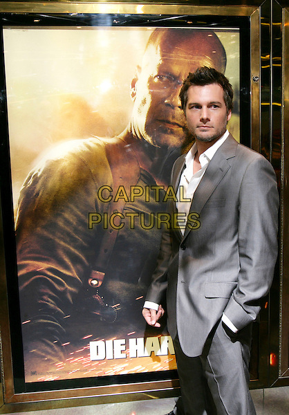 "LEN WISEMAN .Leaving the UK premiere of ""Die Hard 4.0: Live Free or Die Hard"" at the Empire Leicester Square, London, England..June 20th, 2007.full half 3/4 length grey gray suit hands in pockets .CAP/CAM.©Andre Camara/Capital Pictures"