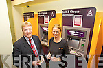 AIB Killarney Branch Manager Bobby O'Dwyer with Linda O'Leary at the lodgement machine at AIB Killarney.